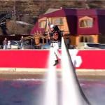 Олимпийский факел выходит из озера Байкал.